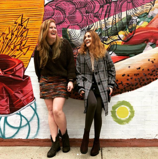Lake Shore Drive founders in front of graffiti wall in Chicago