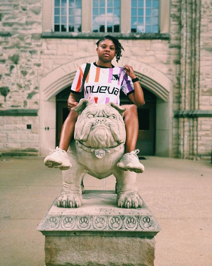 Bria from Soul Culture models Wild NUEVA's World Cup home jersey