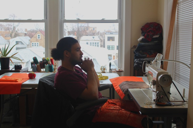 Swaintheory thinks at his sewing table in Chicago