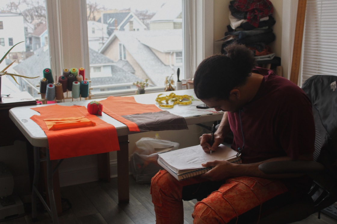 Chicago fashion designer Swaintheory designs in his sketchbook